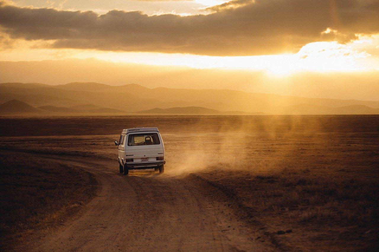 volkswagen campervan on a dirt road