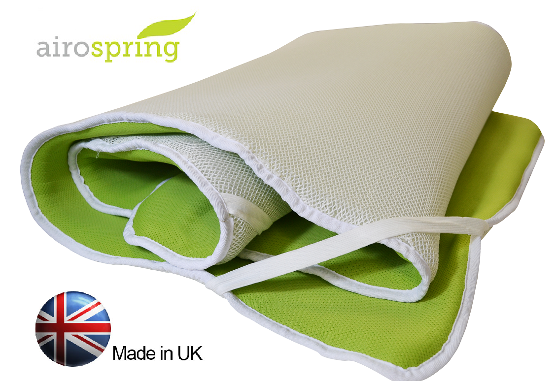 a rolled up mattress topper for camping