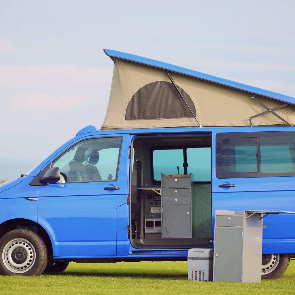 a small blue jerba campervan